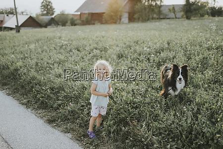 girl going walkies with dog in