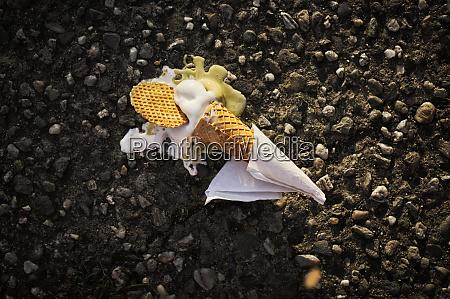 lost ice cream cone on asphalt