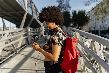 female afro american with headphones and