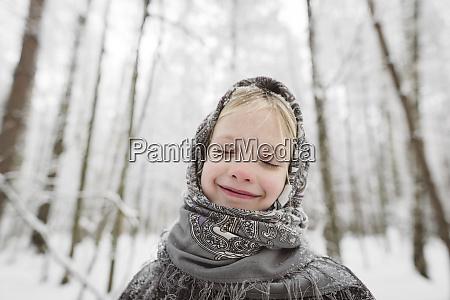 portrait of happy little girl wearing