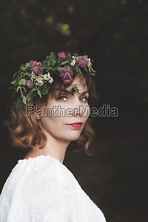 portrait of woman with flower wreath