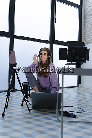 portrait of smiling young woman recording