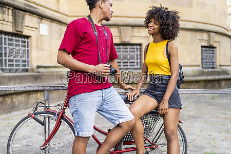 happy young couple with bicycle in