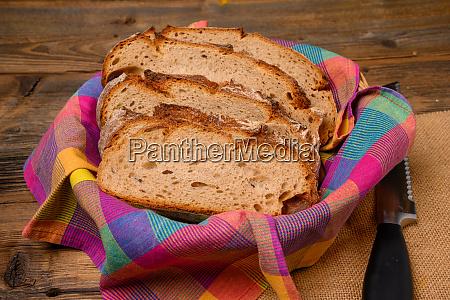 freshly sliced bread in a bread