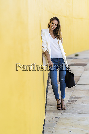 portrait of smiling woman standing at