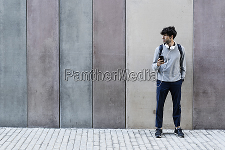 man with cell phone and headphones