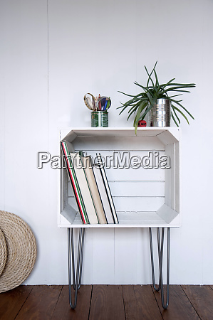 upcycled fruitcrate used as bookshelf