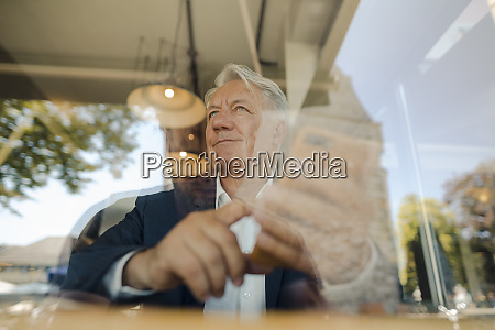 senior businessman using cell phone in