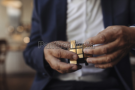 close up of businessman with rubiks