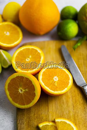 freshly cut oranges on cutting board