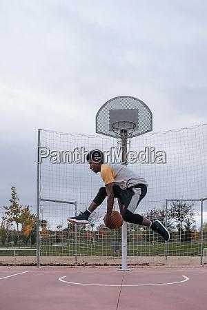 teenager playing basketball