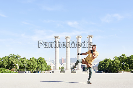 man doing kickboxing exercise outdoors in