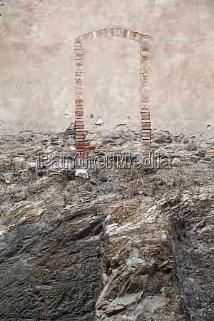 spain catalonia bricked up doorway of
