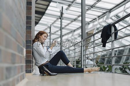 businesswoman sitting on the floor in