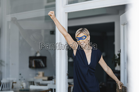 businesswoman wearing super hero masks pretending