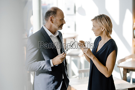 businessman and woman talking about solutions