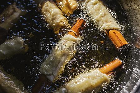 spanish christmas pastry pestinos in frying
