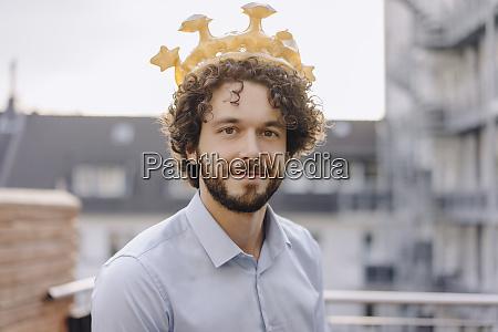 portrait of confident businessman on roof