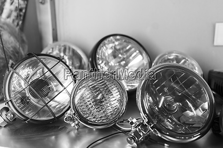 close up of various motorcycle headlights