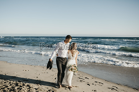bride and groom walking on the