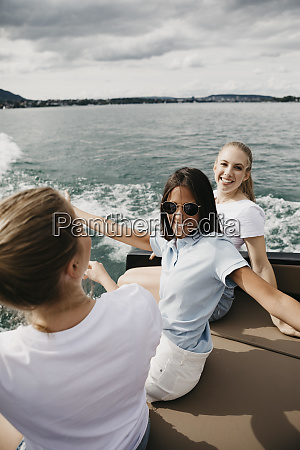 happy female friends on a boat
