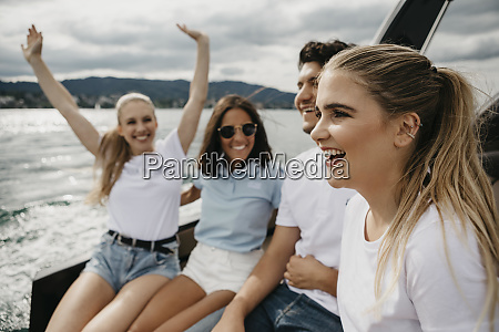 happy friends on a boat trip