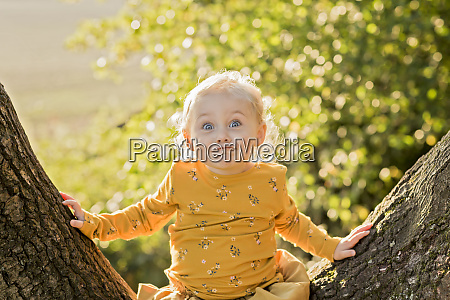 portrait of blond toddler girl sitting
