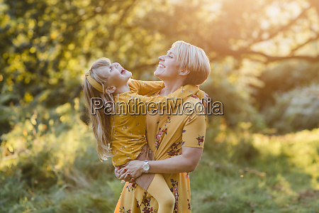 mother and little daughter laughing together