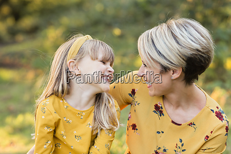 mother and little daughter having fun