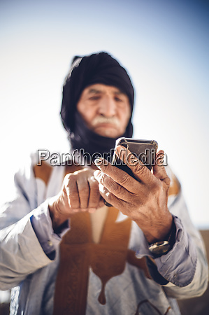 senior man using cell phone in