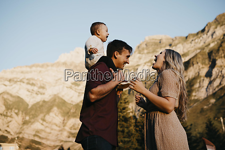 happy family with little son on