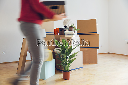 woman carrying cardboard box in a