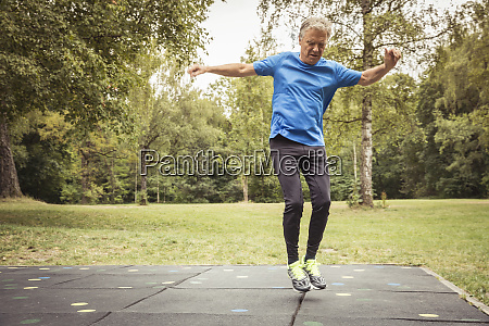 senior man on trampolin mats