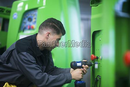skilled worker working in conveyor belt