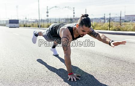 young man doing balance exercise on