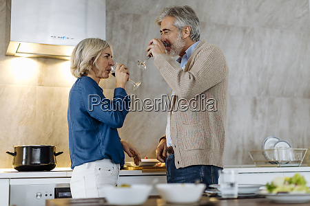mature couple drinking red wine in