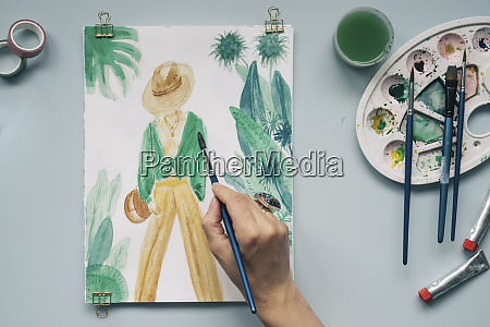 cropped image of hand painting fashionable