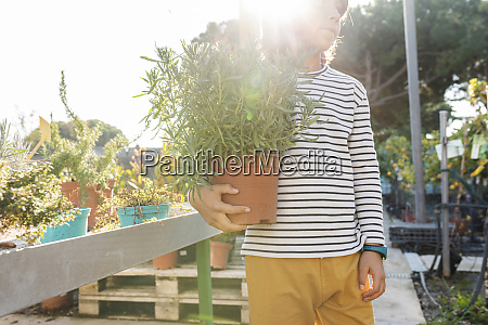boy with potted plant at plant