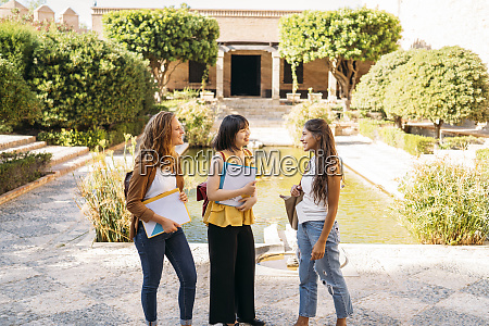three female friends visiting a formal