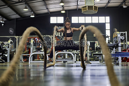 female athlete doing strength training with