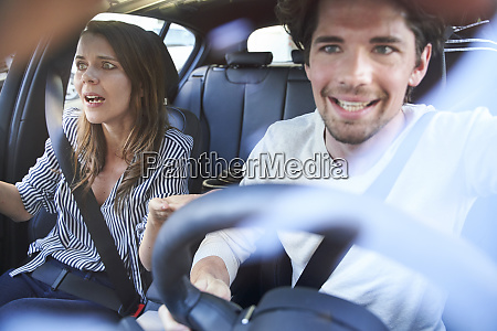 shocked couple in a car with