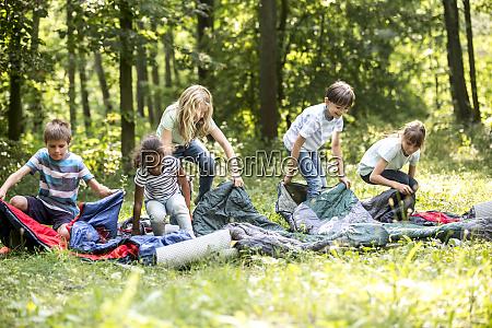 school children unpacking their sleeping bags