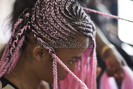 young woman with pink braids close