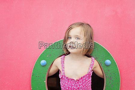 portrait of toddler girl on playground