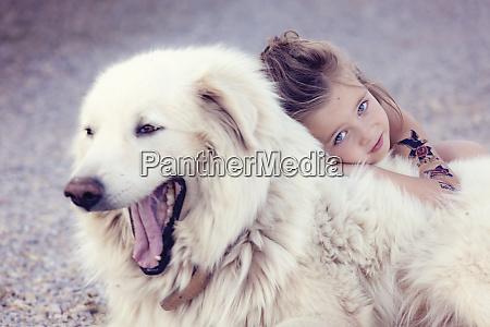 portrait of little girl cuddling yawning