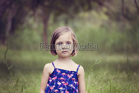 portrait of little girl in nature