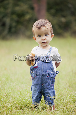 portrait of little boy wearing denim