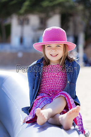 portrait of fashionable little girl sitting