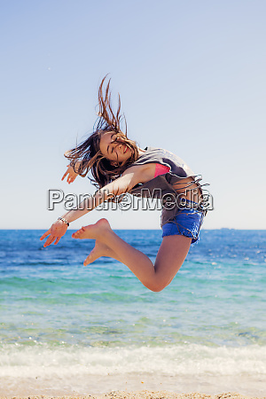 girl jumping in the air at