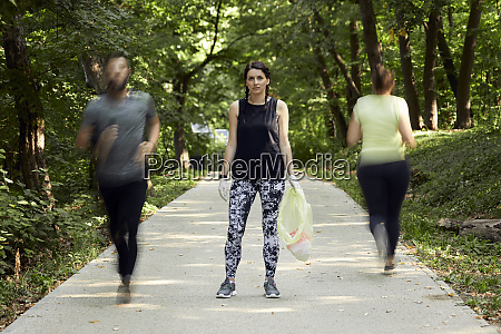 people running and young woman plogging